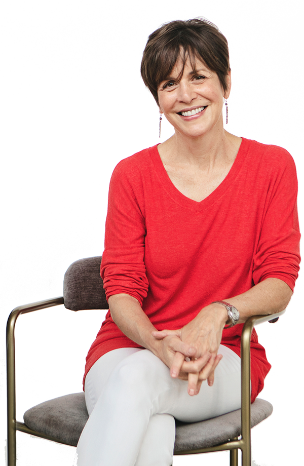 Photo of Linda Goldman sitting in a chair and smiling