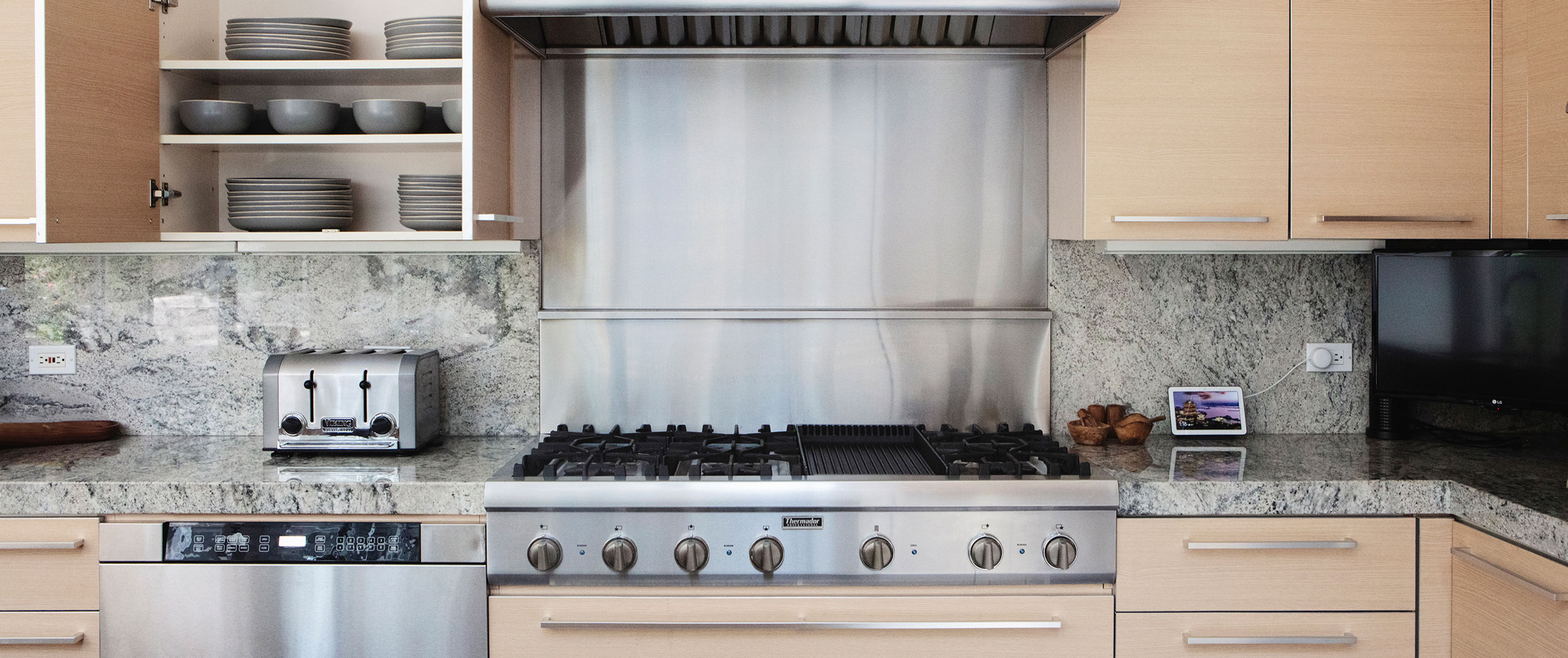 A clean modern kitchen with stainless steel appliances