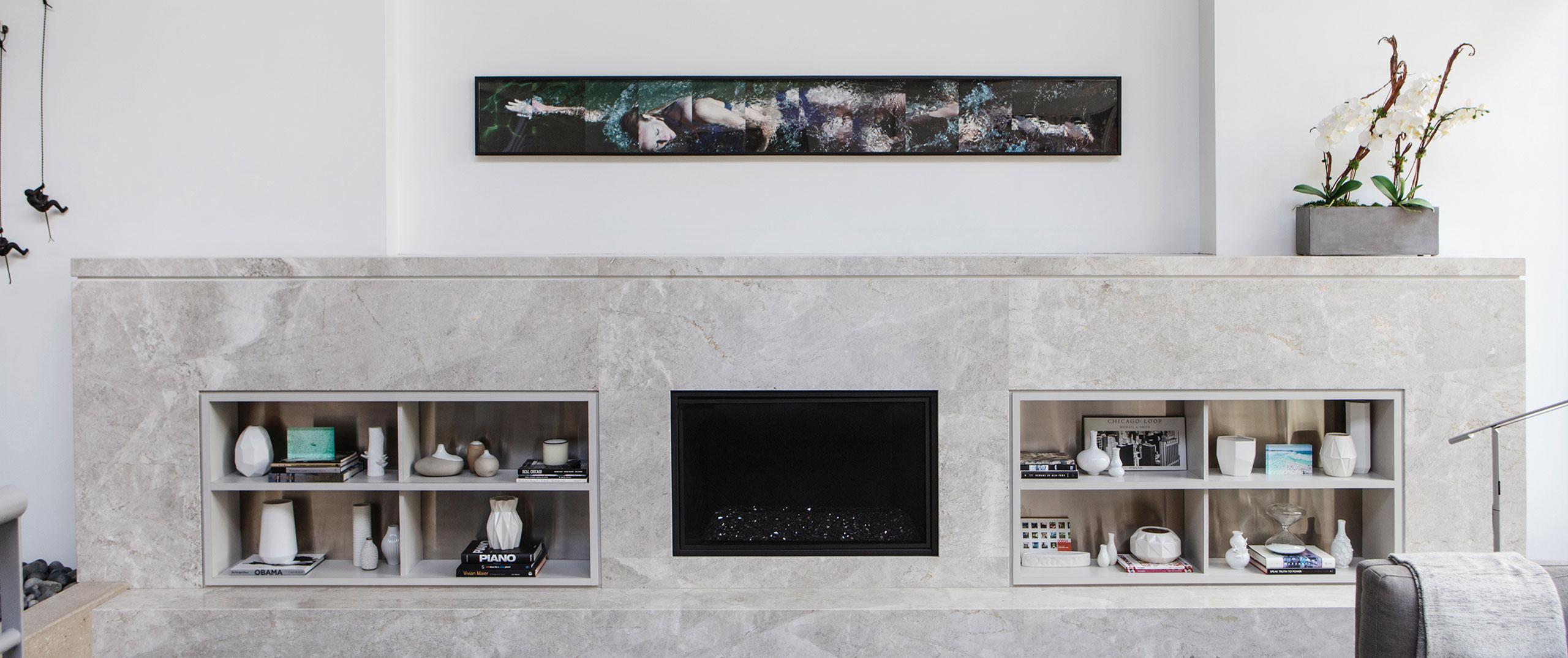 A sleek, modern granite fireplace