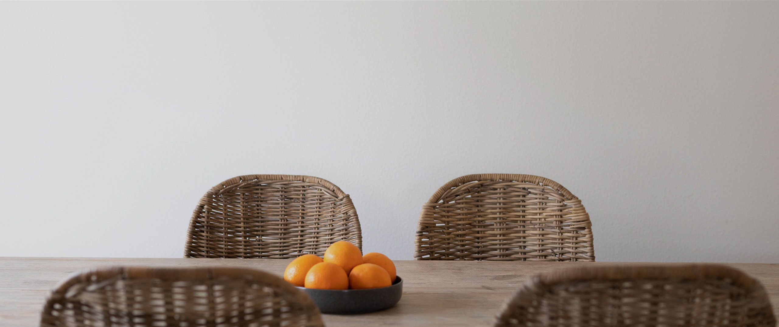 Rattan chairs around a dining table