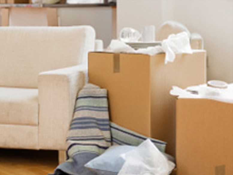 moving boxes stacked next to a couch